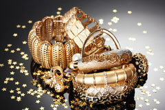 Beautiful golden jewelry Stock Images