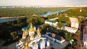 Beautiful Golden Kiev Ukraine St. Michael`s Golden-Domed Monastery. View from above. aerial video footage. Landscape. City view to Dnipro and Pishokhidnyy stock video footage