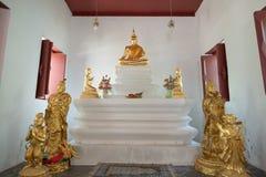 Beautiful of golden old Buddha statue in church at  Wat Lom Maha. Chai Chumphon, Rayong, Thailand Royalty Free Stock Image