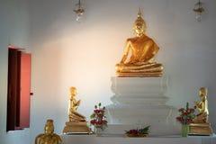 Beautiful of golden old Buddha statue in church at  Wat Lom Maha. Chai Chumphon, Rayong, Thailand Stock Image