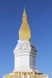 Beautiful golden pagoda. Beautiful golden pagpda with blue sky, Laos Royalty Free Stock Image