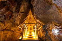 Golden Pagoda in cave at Wat Phra Sabai, Lampang, Thailand. Beautiful Golden Pagoda in cave at Wat Phra Sabai, Lampang, Thailand royalty free stock photos