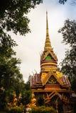 Beautiful golden pagoda with decorative Thai style fine art at public Buddhist Wat Phu Phlan Sung, Nachaluay, Ubon Ratchathani, Th royalty free stock photos