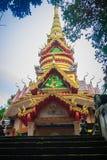 Beautiful golden pagoda with decorative Thai style fine art at public Buddhist Wat Phu Phlan Sung, Nachaluay, Ubon Ratchathani, Th royalty free stock photo