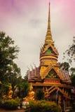 Beautiful golden pagoda with decorative Thai style fine art at public Buddhist Wat Phu Phlan Sung temple, Nachaluay, Ubon Ratchath stock photography