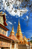 Beautiful golden pagoda under deep blue sky Stock Images
