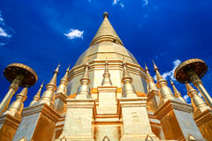 Beautiful golden pagoda under deep blue sky Stock Photography