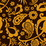 Beautiful golden paisley seamless background Stock Images