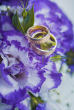 Beautiful golden rings on the blue wedding bouquet Stock Photography