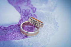 Beautiful golden rings on the blue wedding dress Royalty Free Stock Photos