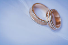 Beautiful golden rings on the blue wedding dress Royalty Free Stock Photo
