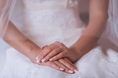 Beautiful golden rings on the blue wedding dress Stock Photo