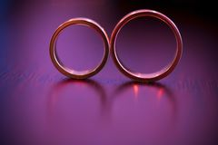 Beautiful golden rings on the table Royalty Free Stock Images