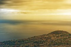 Beautiful golden sky over the coastline on Madeira island. Beautiful golden sky over the coastline on Portuguese island of Madeira royalty free stock photo