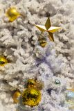 Beautiful Golden star and golden balls on the outdoor white Christmas tree decoration. For Christmas eave and new year celebration Stock Photography