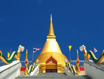 Beautiful golden stupa soars into blue sky Stock Image