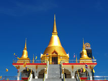 Beautiful golden stupas soar into blue sky Royalty Free Stock Photography
