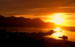Sunrise at The Worlds End. A beautiful golden sunrise over Ushuaia harbour at The Worlds End Royalty Free Stock Photo