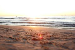 Beautiful golden sunset on the beach. On baltic sea with waves Stock Images