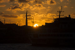 Beautiful golden sunset behind a black silhouette of a bridge and buildings in Istanbul stock images