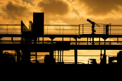 Beautiful golden sunset behind a silhouette of a big cargo ship Royalty Free Stock Photography