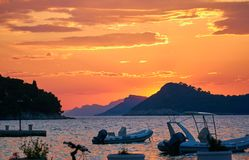 Beautiful golden sunset and boats royalty free stock photo
