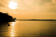 A beautiful golden sunset on the lake. Royalty Free Stock Image