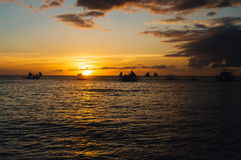 Beautiful golden sunset over fishing boats on the sea Royalty Free Stock Image