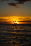 Beautiful golden sunset over fishing boats on the sea Royalty Free Stock Photography