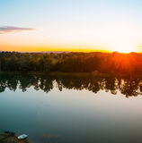 Beautiful Golden Sunset over the lake and a lonely boat Stock Photography