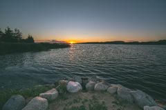 Beautiful Golden Sunset over the lake in Poland Stock Photo
