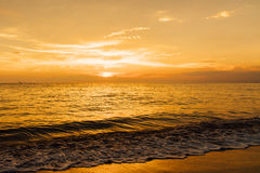 Beautiful golden sunset on sea shore. Landscape ocean waves at sunset Royalty Free Stock Image