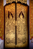 Beautiful golden Thai painting on the door in tample Royalty Free Stock Photography