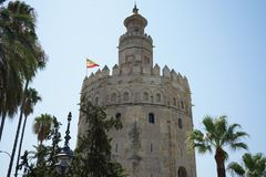 Torre de oro in sevilla spain. Beautiful golden tower in sevilla spain for vacation and travel stock images