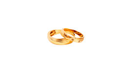 Beautiful golden wedding rings. Wedding rings for husband and wife isolated on white background Stock Photo