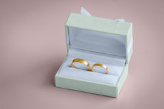 Beautiful golden wedding rings inside a vintage box Royalty Free Stock Image