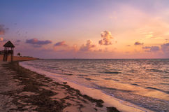 Sunrise Over Cancun Beach. Beautiful golden yellow sunrise over the beach in Cancun, Mexico stock image