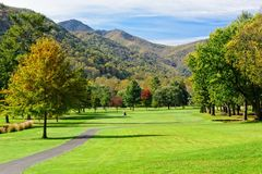 Golf Course in the Mountains. Beautiful golf course fairway in the mountains during the season of Fall Royalty Free Stock Image