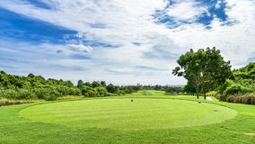 A Beautiful golf course , sand bunker and green grass royalty free stock images