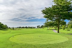 A Beautiful golf course , sand bunker and green grass royalty free stock photos