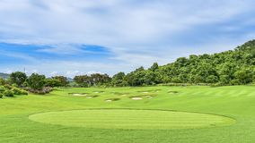 A Beautiful golf course , sand bunker and green grass stock photo