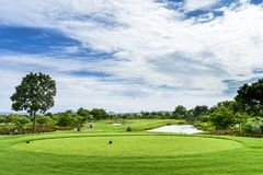 A Beautiful golf course , sand bunker and green grass stock image