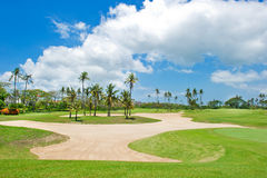Beautiful golf course. sand trap anf palm trees. Bali, Indonesia Royalty Free Stock Photography