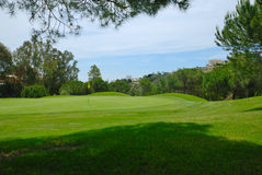 Beautiful golf hole. A beautiful golf course  in Marbella, near Banus Harbour in Andalusian, spain Royalty Free Stock Photo