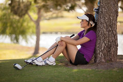 Beautiful golfer taking a break Royalty Free Stock Images