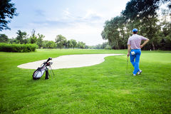 Beautiful golfing scenery with a golfer holding a club Royalty Free Stock Photo