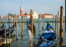 Beautiful gondolas approaching piers of Venice. Venice, Italy - 20 July, 2017 : beautiful gondolas approaching piers of Venice, with happy amazed tourists in Royalty Free Stock Images