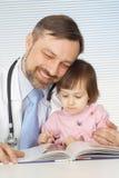A beautiful good doctor treats a child Stock Photo