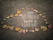 Beautiful good heart quote with love sign from autumn leaves royalty free stock images