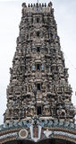 Beautiful Gopuram of a Hindu Temple. Ornate with figures and figurines of Gods and Goddesses. Reminiscent of Tamil Architecture developed during the Chola Stock Photo